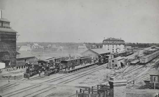 Black and white photograph of the arrival of the Milwaukee train, Austin, Minnesota, 1874.
