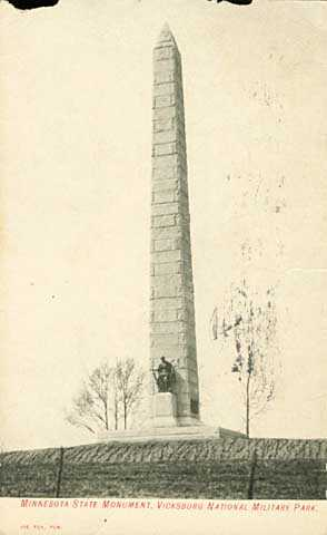 Photograph of an obelisk with a statue of a soldier at its base.