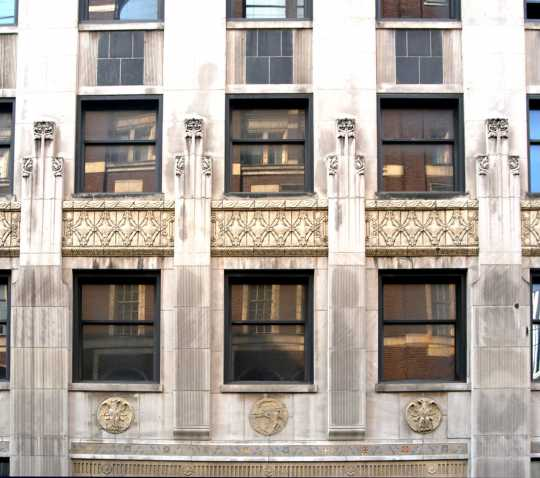 Color image of thefacade of the Minnesota Building above the main entrance, 2009.