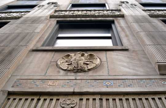 Color image of an eagle medallion and tile work above the main entrance of the Minnesota Building, 2009.
