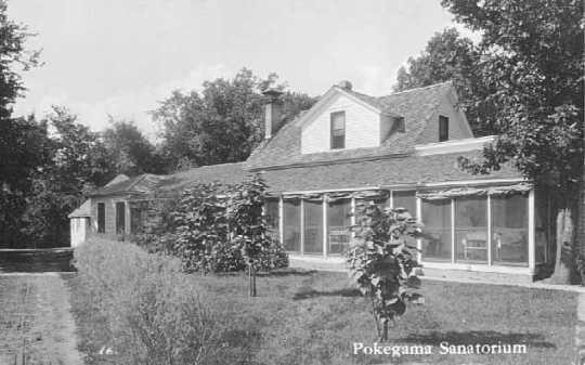 Black and white photograph of Pokegama Sanatorium cottages, c.1920.