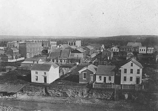 Photograph taken by Benjamin Franklin Upton from the steeple of the Ramsey County Courthouse in St. Paul, 1857. The Day and Jenks drug store appears in the middle-left of the image.
