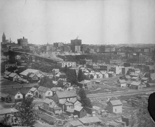 Black and white photograph of the West Side Flats and Wabasha Bridge, 1904.