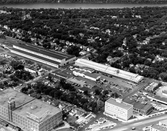 Black and white aerial photograph of Weyerhaeuser Twin City yard and surrounding area, 2563 Franklin Avenue, St. Paul, 1953.