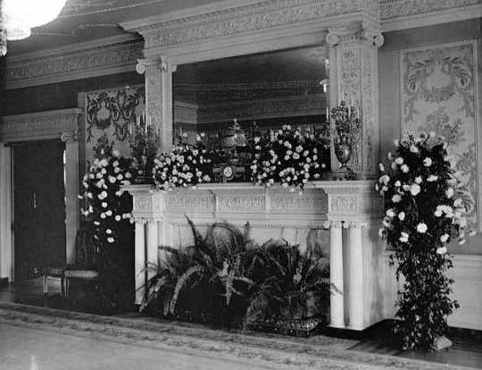 Black and white photograph of a drawing room decorated for Charlotte Hill's wedding to George T. Slade at the James J. Hill house, 240 Summit Avenue, St. Paul, 1901. Photographed by Charles A. Zimmerman.