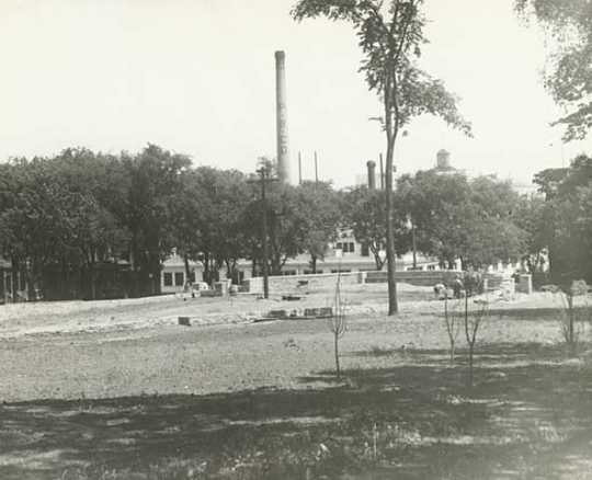Black and white photograph of the wading pool being built in Central Park, 1929.