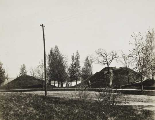 Black and white photograph of two of the mounds, with walking path, at Indian Mounds Park, ca. 1900.