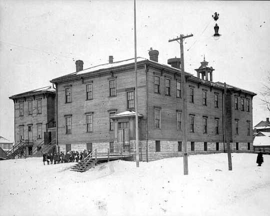 Black and white photograph of Lafayette School, corner of Kentucky and Fenton, the only public school in the Flats, c.1921.