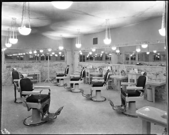 Black and white photograph of the St. Paul Athletic Club barbershop, c.1925. Photograph by Charles P. Gibson.