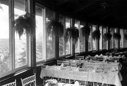 Black and white photograph of the interior of the dining room of the University Club, overlooking St. Paul, June 22, 1977. Photographed by Julian G. Plante.