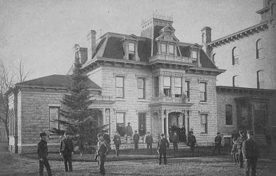 Black and white photograph of the front exterior of the Minnesota State Reform School. Taken by T.W. Ingersoll c.1875.
