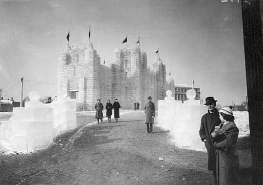 Black and white photograph of the 1937 Winter Carnival Ice Palace, looking west toward State Office Building.