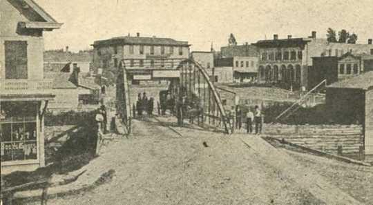 Black and white photograph of Bridge Square, Northfield, 1876.