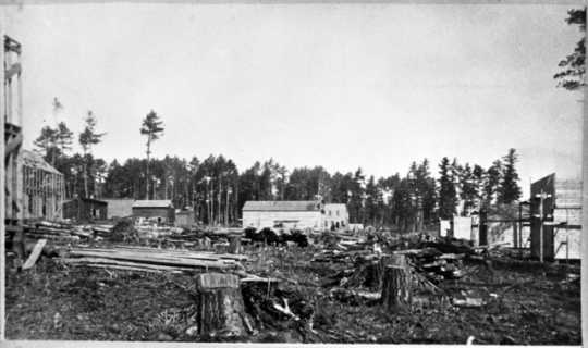 Black and white photograph of the boomtown of Merritt that sprang up near the Biwabik Mine, 1892.