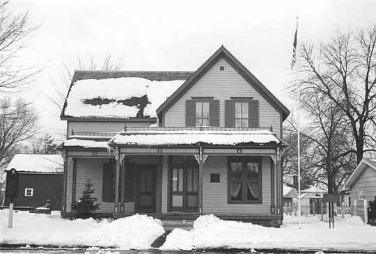 Black and white photograph of Sinclair Lewis' childhood home, December 1975. Photographed by Henry Harren.