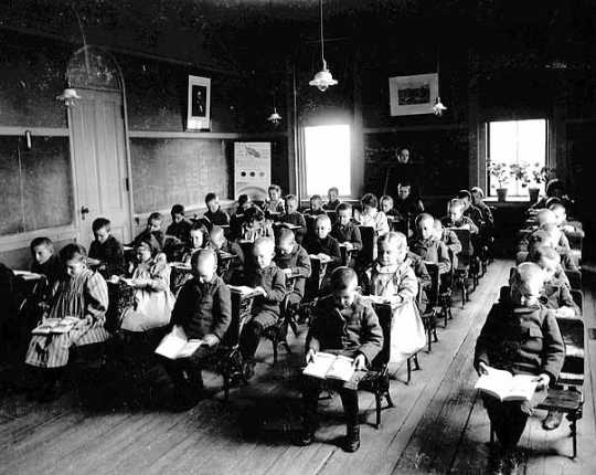 Black and white photograph of a classroom at the State School, c.1905.