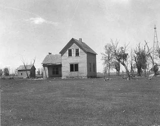Black and white photograph of a farm abandoned after successive years of drought, possibly near Breckenridge in Wilkin County, 1939.