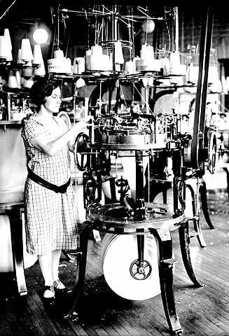 photograph of a woman operating a Munsingwear knitting machine