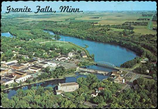 Color postcard showing an aerial view of Granite Falls, c.1965.