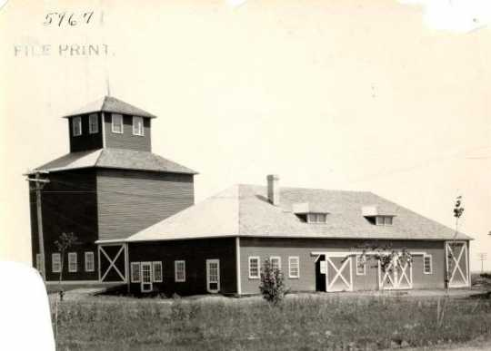 Black and white photograph of the machine shed and elevator on the grounds of the Northwest Experiment Station were built in 1913.
