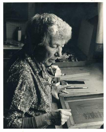 Gene Ritchie Monahan making a silk screen