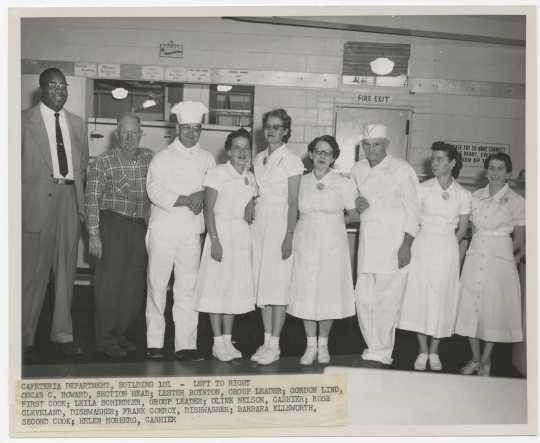 Twin Cities Arsenal cafeteria section head Oscar C. Howard and cafeteria employees, 1957. Industrial Relations Photographs, Twin Cities Army Ammunition Plant files, box 143.E.17.2F.,  Manuscripts Collection, Minnesota Historical Society.