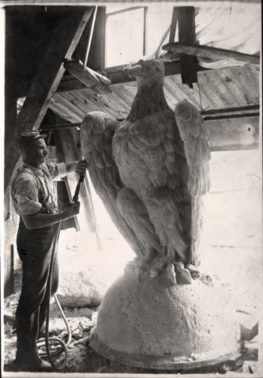 Man working on the eagle at the top of the Capitol