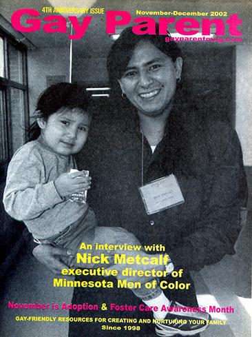 Nick Metcalf (Čhetáŋzi), with adopted son, Sonny (Hokšíčala Čhaŋté Ma Yuhá), on the cover of Gay Parent magazine, November/December 2002.