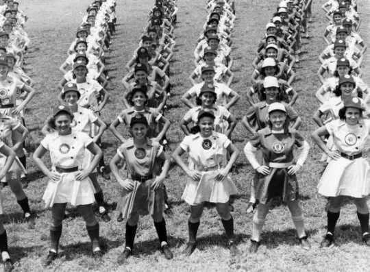 All American Girls Professional Baseball League members performing calisthenics in Opalocka, Florida. Black and White photo