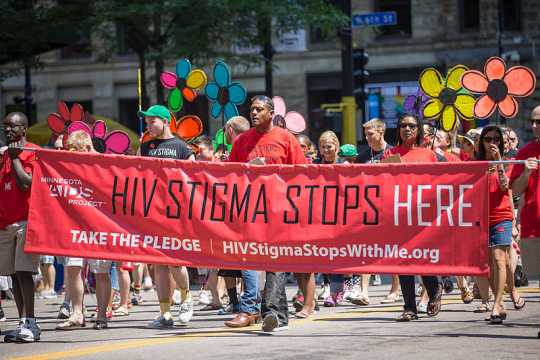 Minnesota AIDS Project volunteers marching in the 2013 Pride Parade