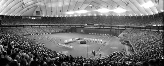Black and white photograph of a panorama of the field from the stands during the 1985 MLB All-Star Game at the Metrodome on July 16, 1985.