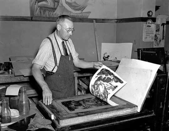 Black and white photograph of a lithographer at work, 1938.
