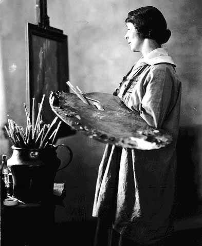 Black and white photograph of Elsa L. Jemne working at an easel, 1922.