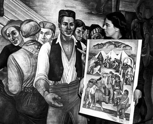 Black and white photograph of Lucia Wiley at work on a mural for the Moorhead High School, 1941.
