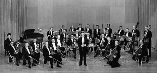Black and white photograph of the St. Paul Chamber Orchestra on stage, ca. 1959.