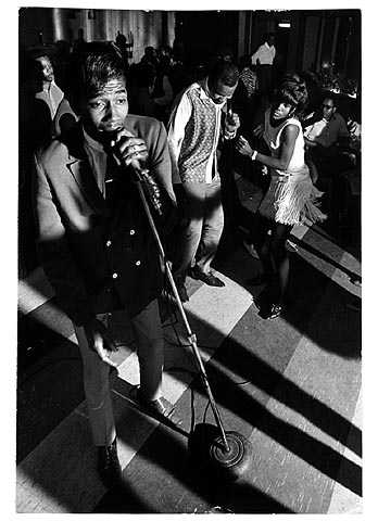 Singer Maurice McKennies with The Blazers performing in the Cozy Bar club on Plymouth Avenue in North Minneapolis, ca. 1968. Photo by Mike Zerby, Minneapolis Tribune.