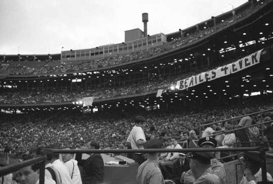 Black and white photograph of Fans at the Beatles concert, Metropolitan Stadium, 8/21/1965. Photograph: Sully, St. Paul Dispatch & Pioneer Press.