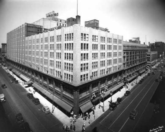 Black and white photograph of the expanded downtown store complex, c.1938. The  original store is in the darker shade.
