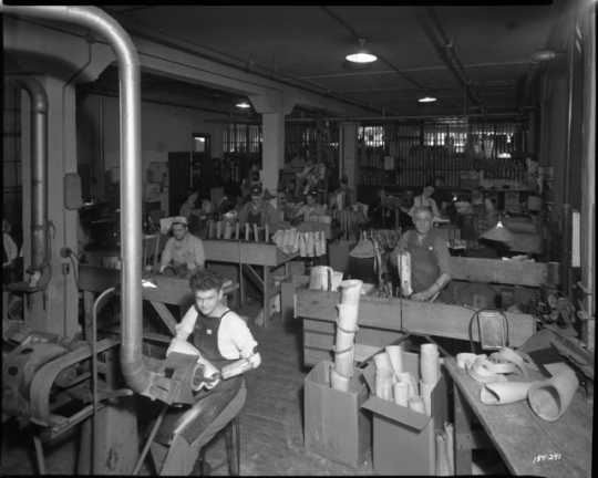 Black and white photograph of the making artificial limbs at Minneapolis Artificial Limb Company, Minneapolis, 1945.