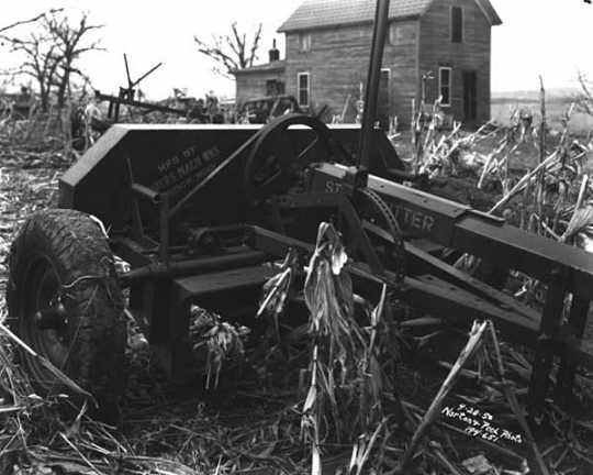 Corn stalk cutter in field. Photograph by Norton & Peel, April 28, 1950.