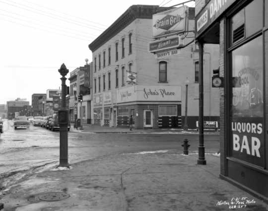 Black and white photograph of the intersection of Washington Avenue and Plymouth Avenue North in North Minneapolis, January 31, 1955.