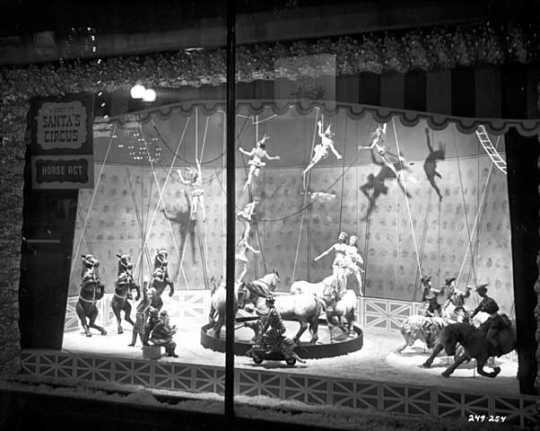 Black and white photograph of Santa's Circus show window, Dayton's, 1957.