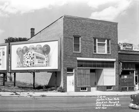 Boarded-up commercial building at 1418 Glenwood Avenue, ca. 1958. The image also shows a billboard advertising Wonder Bread. Photo by Norton & Peel.