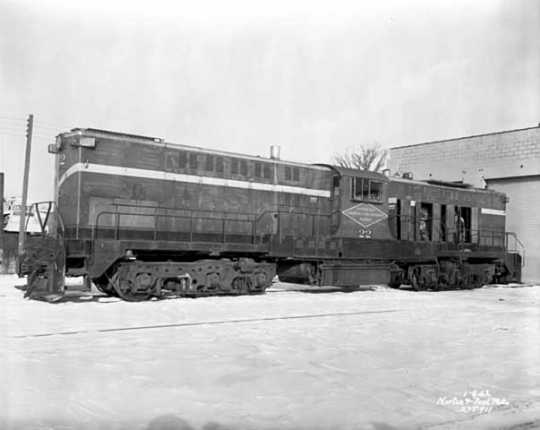 Black and white photograph of a Minneapolis, Northfield and Southern Railway locomotive 22, 1962.