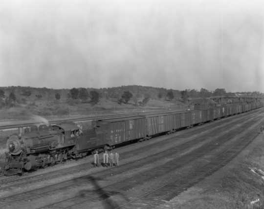 Black and white photograph of a Minneapolis, Northfield and Southern Railway freight train, 1929.