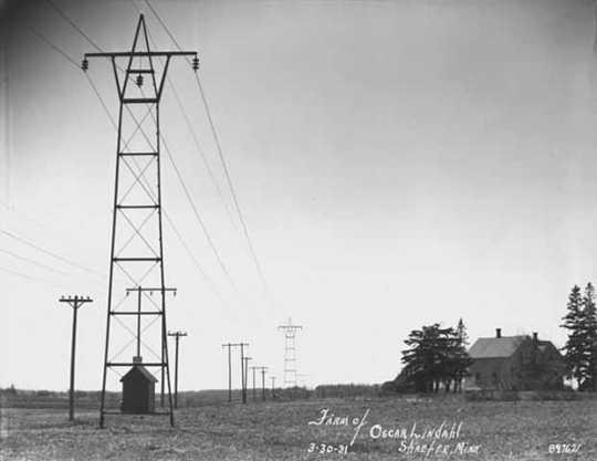 Black and white photograph of rural electrical transmission lines on the farm of Oscar Lindahl, Schaefer, Chisago County, 1931. Photograph by Norton & Peel.