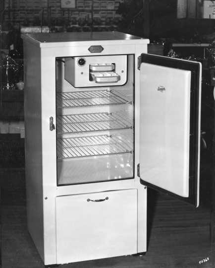 Black and white photograph of an electric refrigerator, 1931.