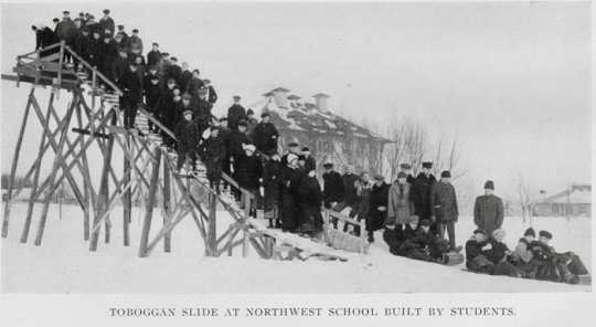 Black and white photograph of a toboggan slide built at the NSWA by students, December 13, 1916. Printed in the school's 1916 yearbook.