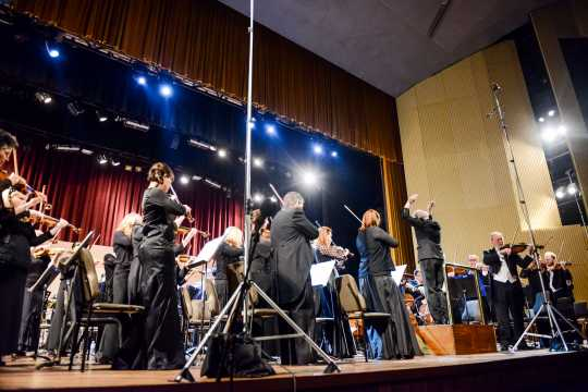 Color image of the Minnesota Orchestra performing the Cuban National Anthem at the Teatro Nacional in Havana. 2015.