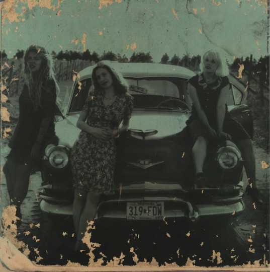 Babes in Toyland (left to right): drummer Lori Barbero, bassist Maureen Herman, and vocalist/guitarist Kat Bjelland. The image was used for promotional materials related to the release of the band's 1995 album Nemesisters.
